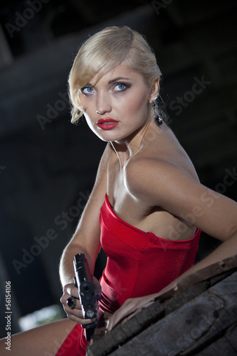 Photo  Sexy assassin with gun