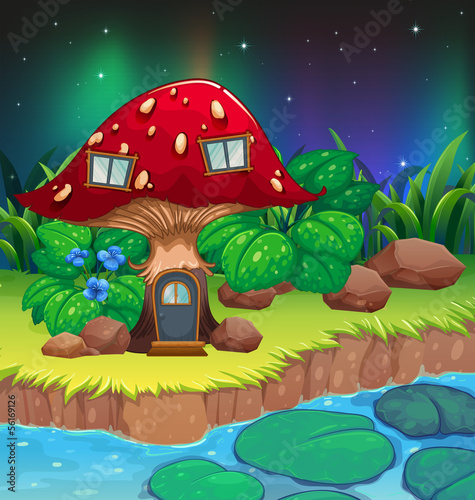 Foto op Aluminium Magische wereld A red mushroom house near the river with waterlilies