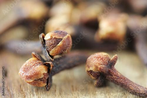 Fotografie, Obraz  Dry clove closeup on wooden background