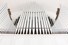 White Church Organ Pipes Photographed From Below And In Symmetry