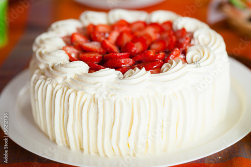 Delicious strawberry cake with strawberries and whipped cream - 56212736