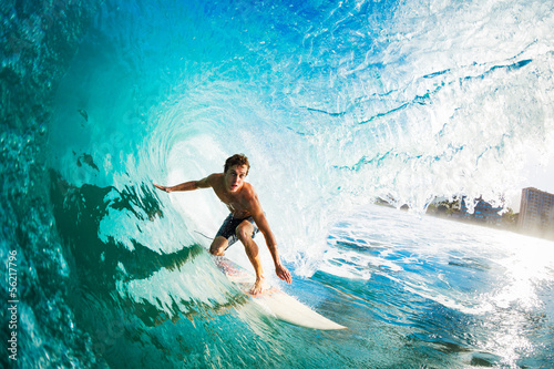 Surfer on Blue Ocean Wave in the Tube Getting Barreled Fotobehang