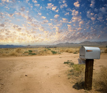 US Mail Box On The Countryside At Sunset. Classic Post Box
