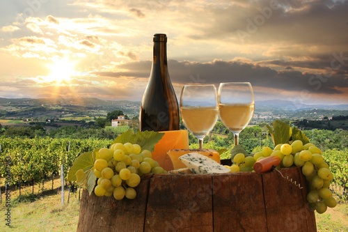 Deurstickers Toscane White wine with barell in vineyard, Chianti, Tuscany, Italy