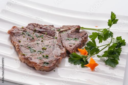 Pork chop on white dish - Buy this stock photo and explore