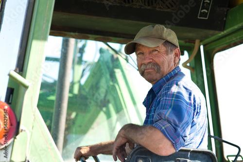 Farmer in his Tractor Fototapet