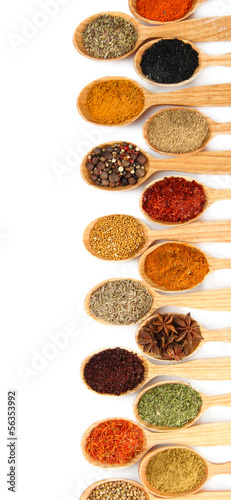 Foto auf AluDibond Gewürze 2 Assortment of spices in wooden spoons, isolated on white
