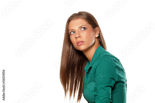 Valokuva  young attractive girl looking unclear at someone