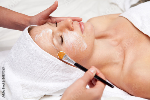 Fotografie, Obraz  Spa therapy for woman receiving facial mask at beauty salon