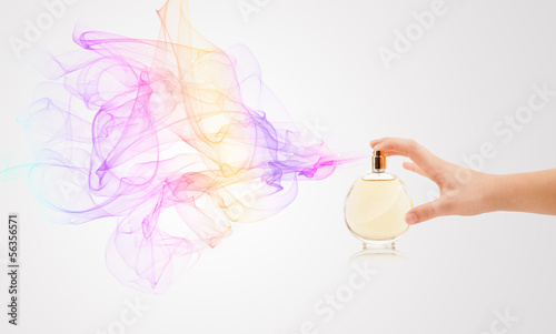 Fototapeta woman hands spraying perfume obraz