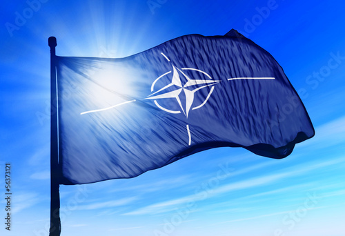 Photo NATO flag waving over the sky