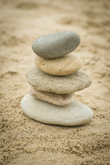 Fototapeta na wymiar Stones piled up on a sand beach