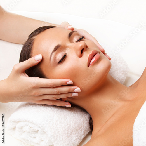 Fotografering  Face Massage.  Close-up of a Young Woman Getting Spa Treatment.