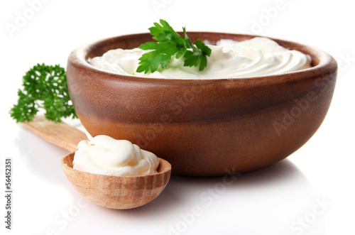 Cadres-photo bureau Nature Sour cream in bowl isolated on white
