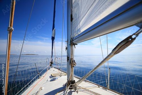 Poster Zeilen Sailboat yacht sailing in blue sea. Tourism