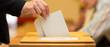 Leinwandbild Motiv Stimmzettel in Wahlurne