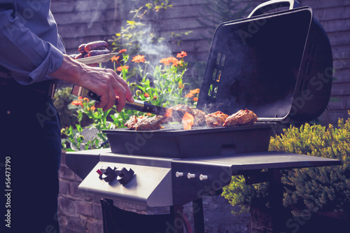 Fotografie, Obraz  Man cooking meat on barbecue