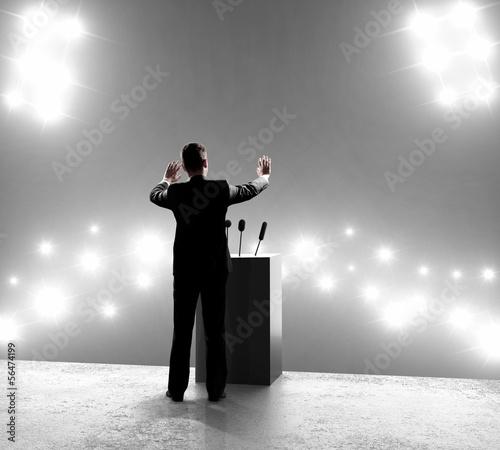 Leinwand Poster businessman standing on podium