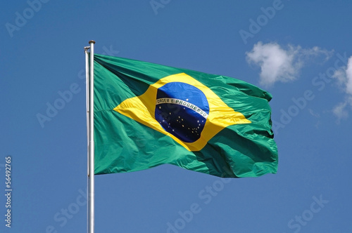Foto  Brazilian flag in blue sky