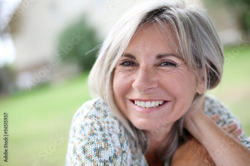 Portrait of serene mature woman in garden Tableau sur Toile