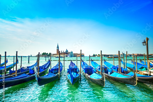 Foto op Aluminium Gondolas Venice, gondolas or gondole and church on background. Italy