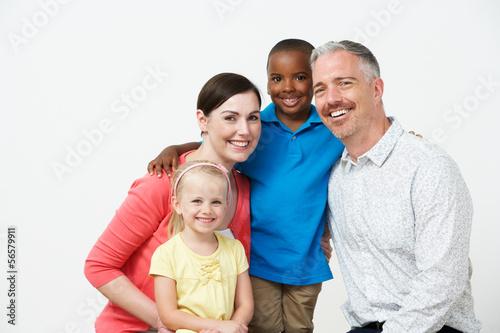 Photo Studio Portrait Of Pre School Teachers With Pupils