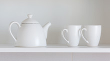 Teapot And Cups On The Shelf