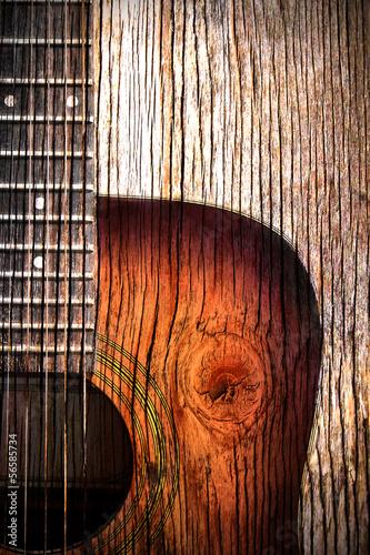 Obraz Gitara akustyczna sztuka na drewnianym tle - fototapety do salonu