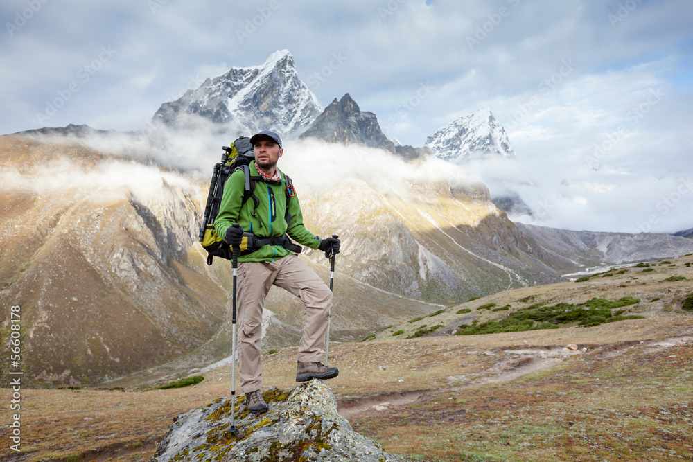 Fototapety, obrazy: Hiker posing at camera on the trek in Himalayas, Nepal