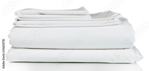 Fotografía  Stack of clean bedding sheets isolated on white