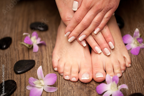 Foto auf Gartenposter Pediküre Relaxing pink manicure and pedicure with a orchid flower