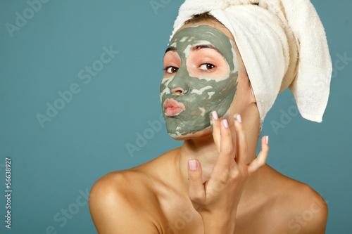 Fotografie, Obraz  Spa teen girl applying facial clay mask. Beauty treatments.
