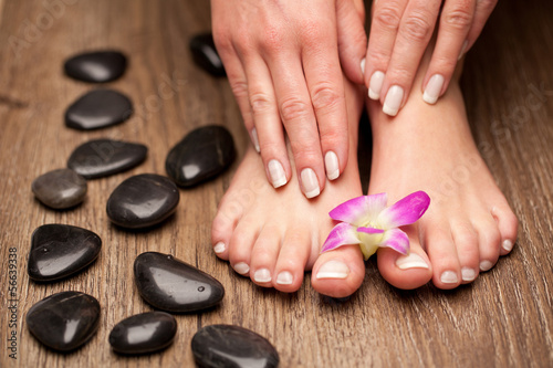 Poster Pedicure Relaxing pink manicure and pedicure with a orchid flower