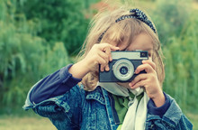 Little Girl Taking Picture Usi...