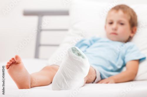 Valokuvatapetti Little child boy with plaster bandage on leg heel fracture or br