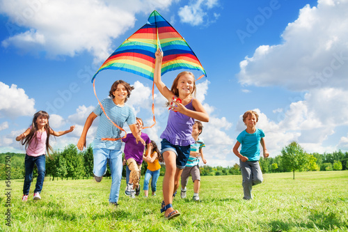 Photo  Many active kids with kite