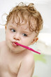 Funny little toddler with toothbrush