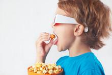 Little Boy In 3D Glasses Eatin...