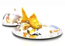 Gold Fish On A Restaurant Cloche