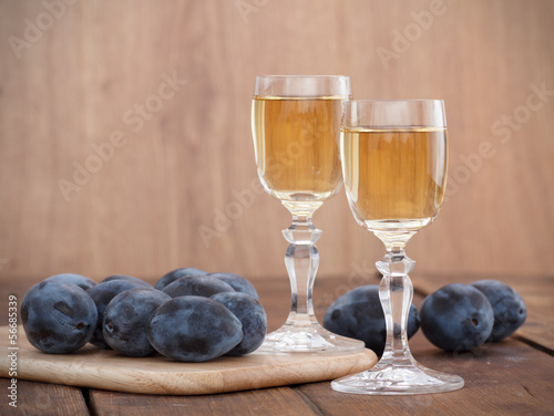 Obraz na plátne Plum brandy or schnapps with fresh and tasty plum