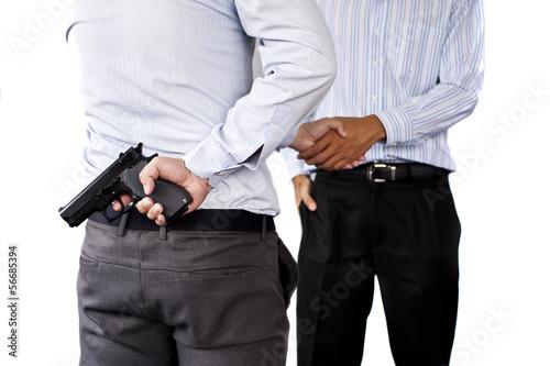 Photo  gun in business man hand