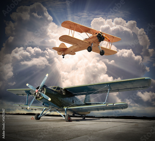 Fotografia  Retro style picture of the biplanes. Transportation theme.