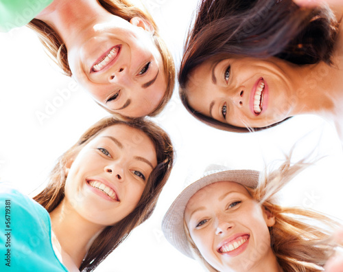 faces of girls looking down and smiling #56719381