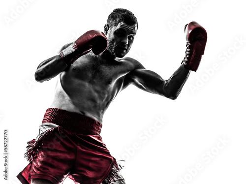 Valokuva one man exercising thai boxing silhouette