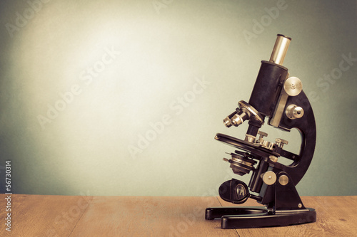 Fotografia  Vintage microscope on table for science background