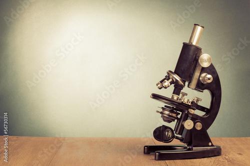 Foto op Plexiglas Retro Vintage microscope on table for science background