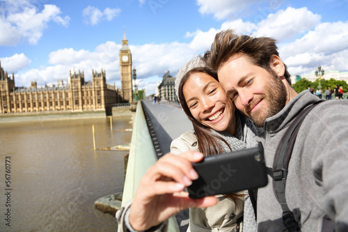 Εκτύπωση καμβά  London tourist couple taking photo near Big Ben