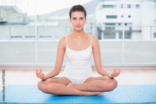Fotobehang School de yoga Calm natural brown haired woman in white sportswear practicing y