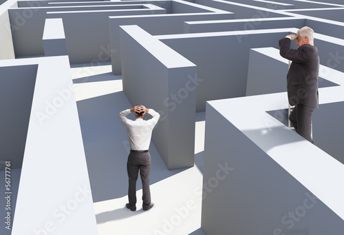Photo  Two businessmen standing in maze