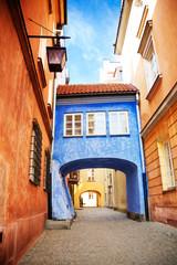 Fototapeta Uliczki Bridge on narrow street in Warsaw